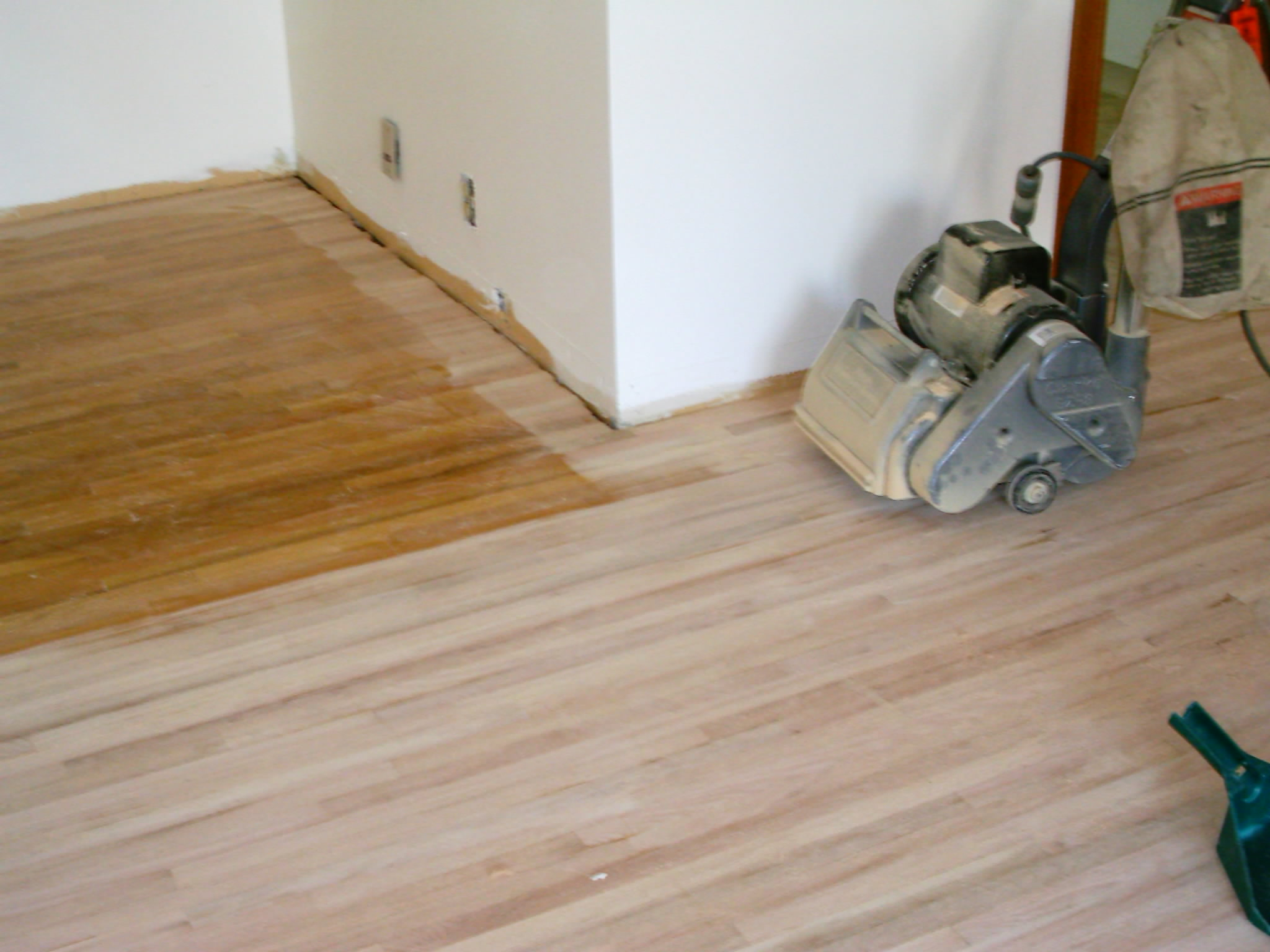 sanding wooden floorboards